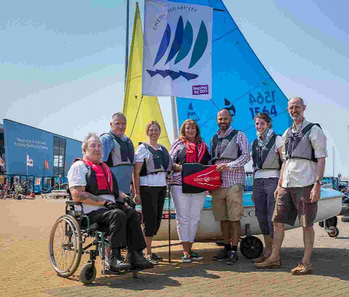 A CELEBRATION: Sailors and volunteer members of the Chesil Sailability group