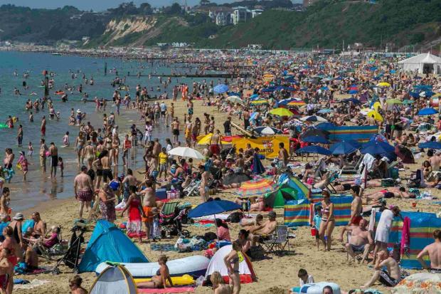 Dorset Echo: CROWDS: Beach fills up as Bournemouth experiences high temperatures
