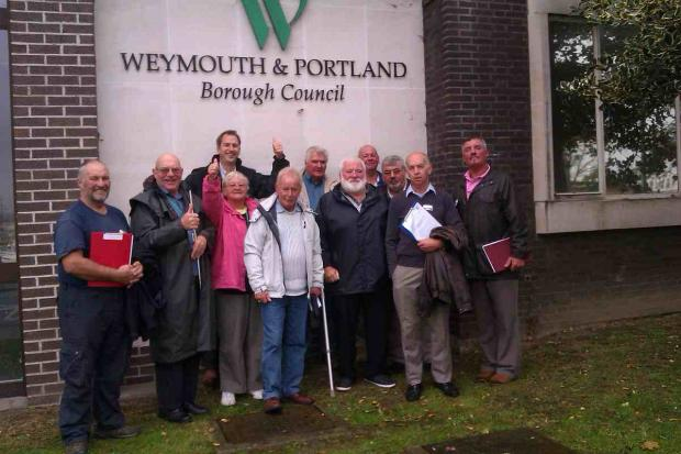 DELIGHT: Supporters and members of Weymouth Angling Society welcome the vote