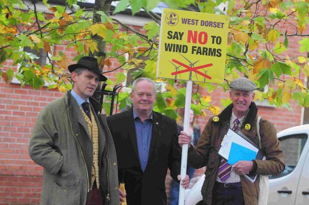 PROTEST: Wind farm protest at Charlton Down. From left, Gawain Towler, Keith Hansford and Geoff Markham