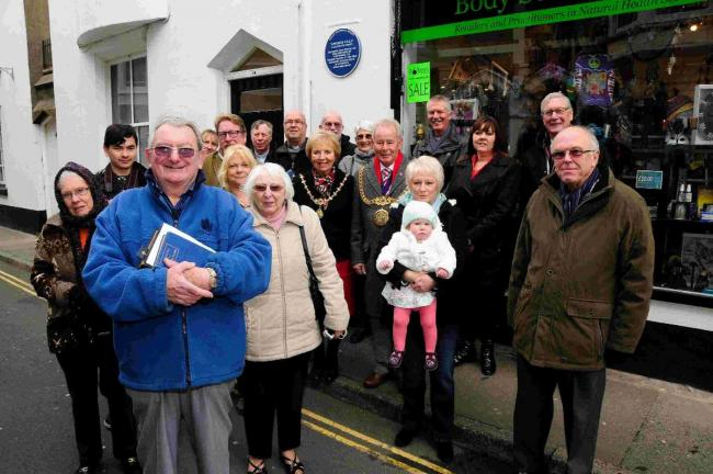 WE HAVE FAITH: John Russell with those attending the unveiling outside Soul and Spirit in Gloucester Street where the new blue plaque, also pictured below, is sited