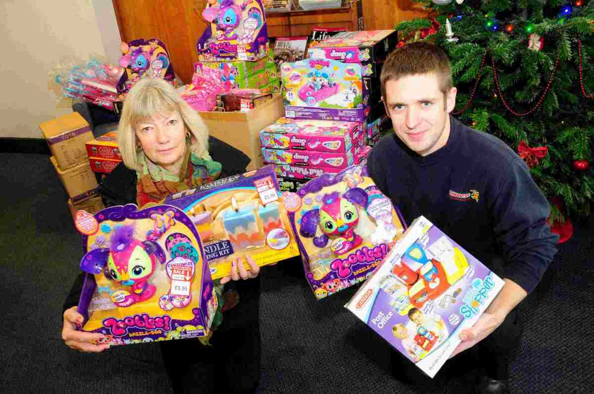 SPECIAL DELIVERY:  Claire Jarmin from the Dorset Echo with Ian Moore from Howleys Toymaster