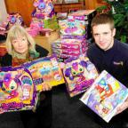Dorset Echo: SPECIAL DELIVERY:  Claire Jarmin from the Dorset Echo with Ian Moore from Howleys Toymaster