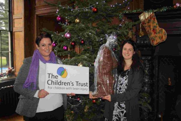 SANTA TREAT: Annie Carter, left, and Melanie Bowman with the giant chocolate Santa