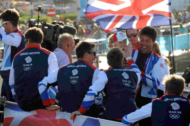 INSPIRATIONAL: Andrew Simpson with his son Freddie greeting Team GB sailors during Weymouth Carnival