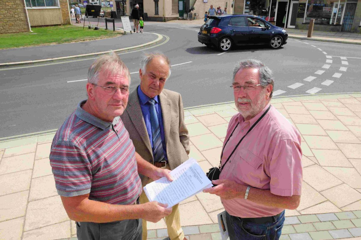 ROAD WOES: Michael Nicks, Malcolm Layton and Chris Cherry with the petition