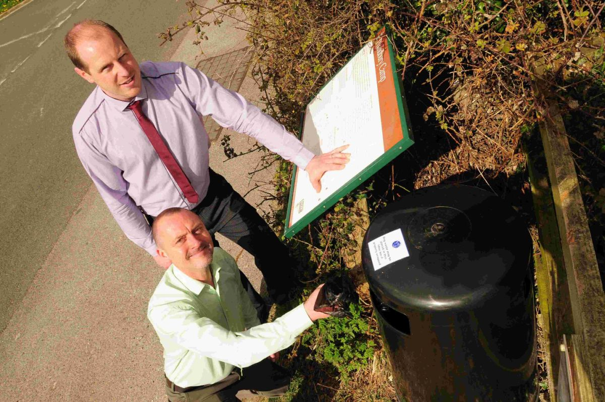 MY PLEA: Councillor David Taylor, bottom, and Dan Carter from Dorset Waste Partnership with new bins at Poundbury Hillfort
