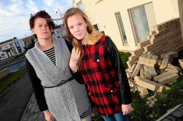 DANGEROUS: Claire and Nikkita McCool outside their house on Victory Road, Portland where a car hit their garden wall