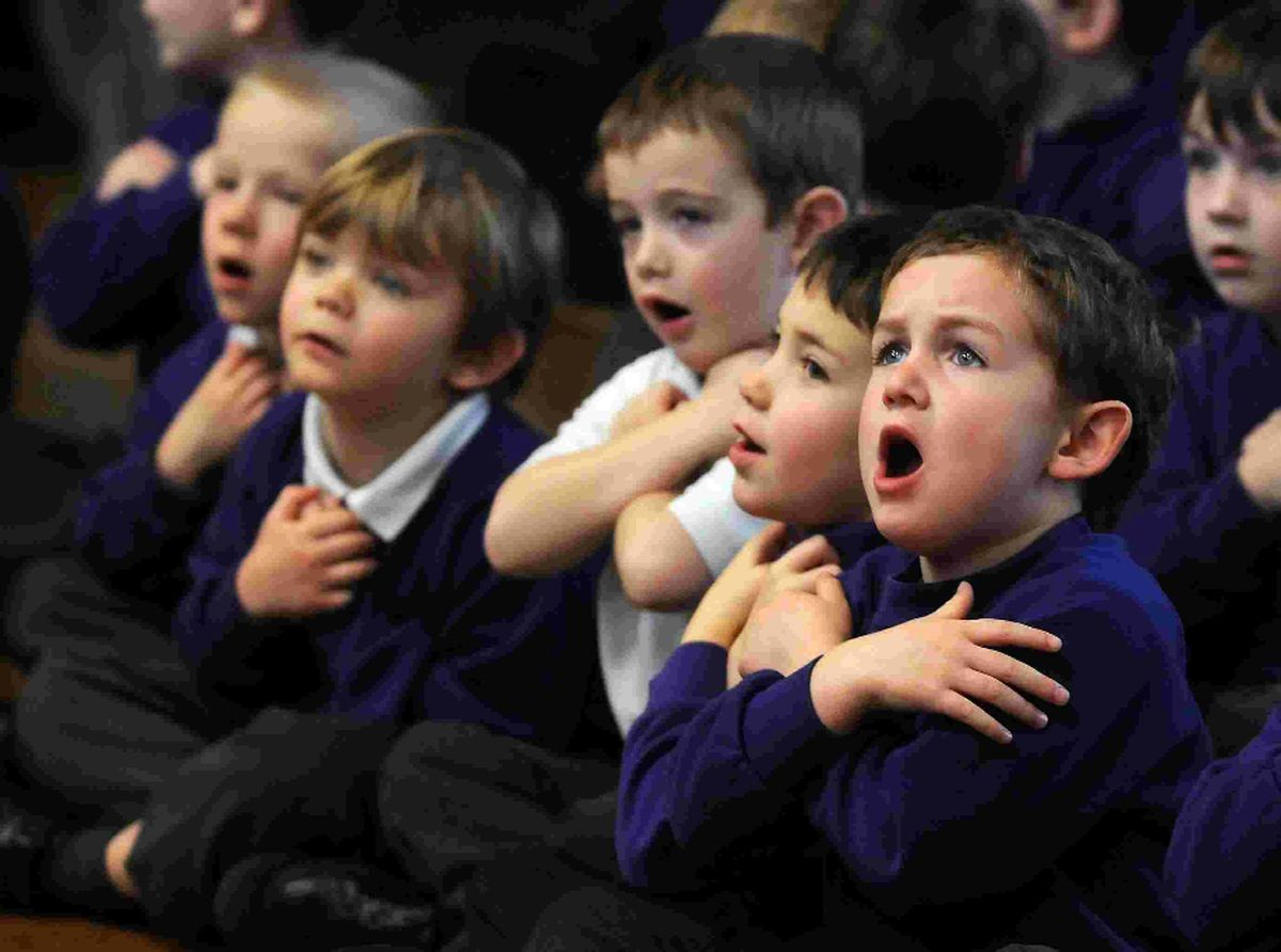 IMPASSIONED: Wyke Regis Infant School pupils take part in a previous singing and signing wor