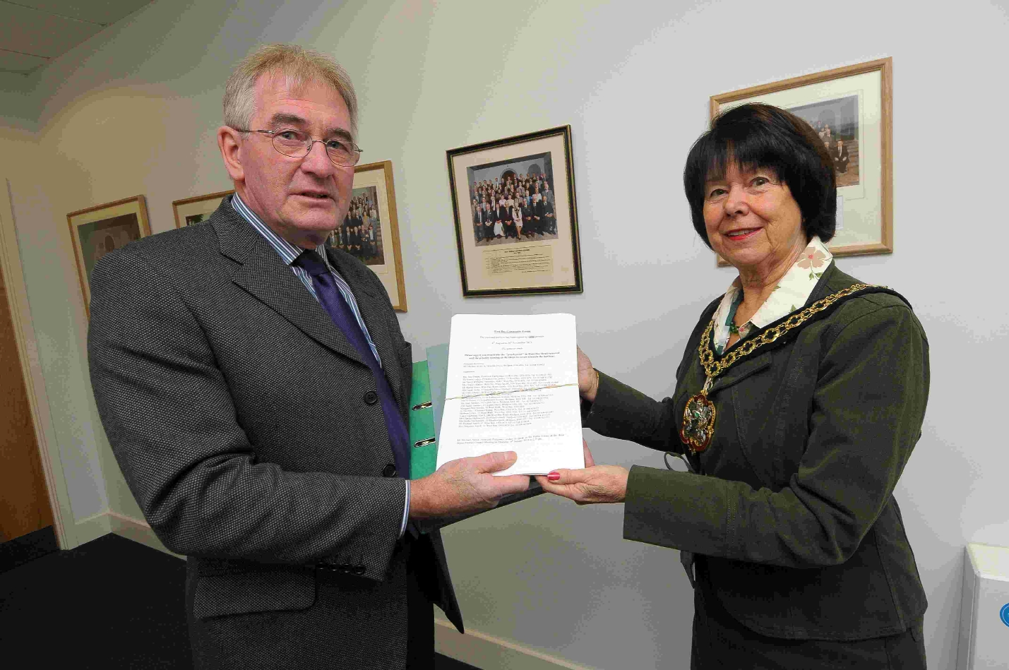 West Dorset District Council chairman Gillian Summers receives the petition from Mike Nicks