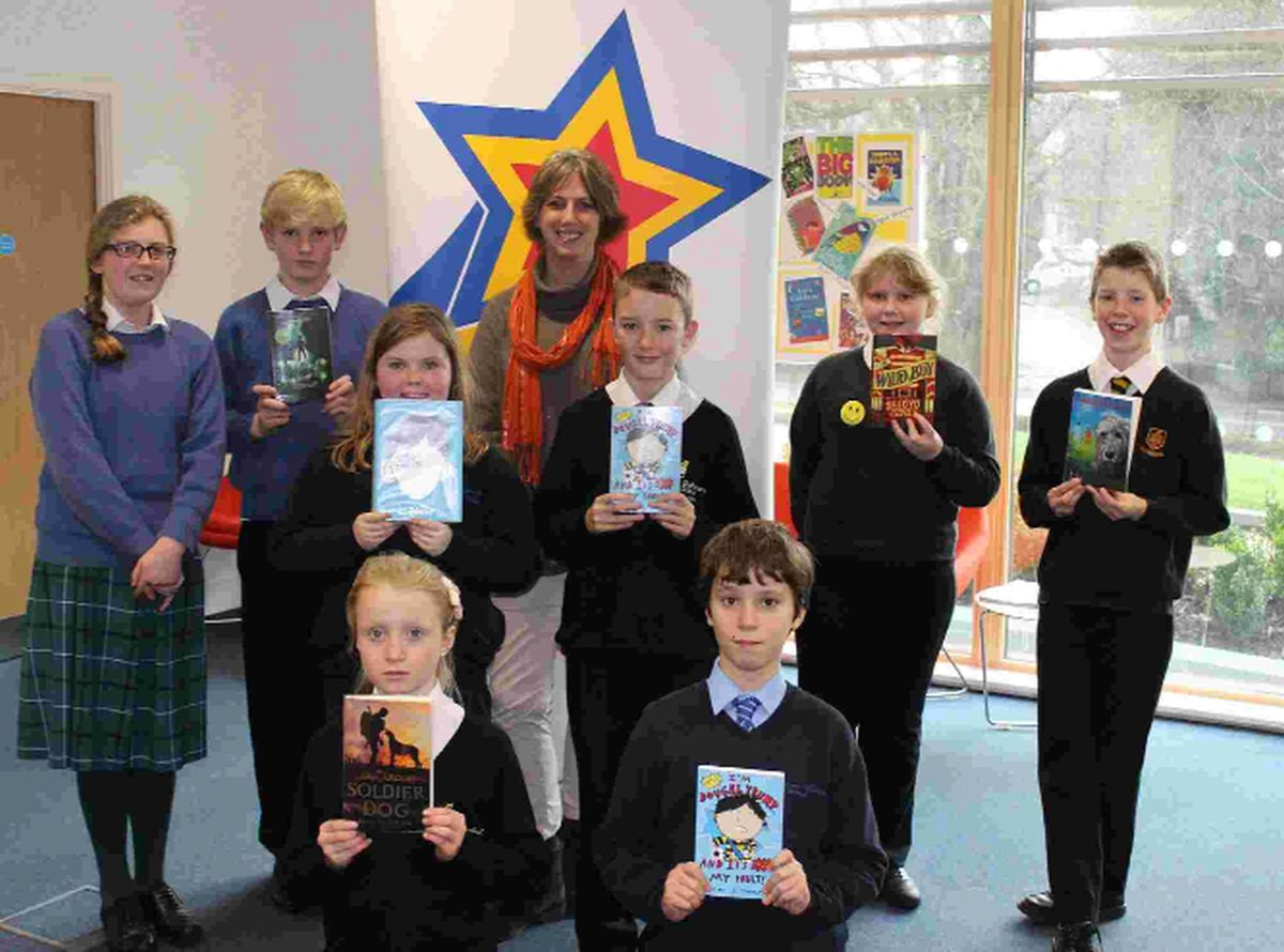 READ ALL ABOUT IT: Gill Lewis with children from schools at the New Horizons Book Awards launch event