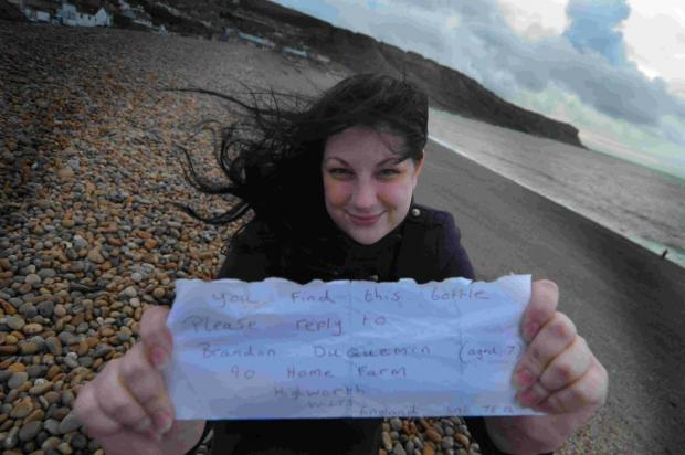 Lucy Blayney with the message she found in a bottle on Chesil beach