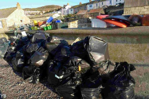 Dorset Echo: REFUSE: Bags of rubbish collected from Chesil Beach at the weekend