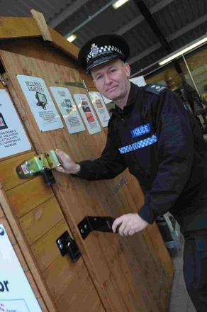 BE SAFE: Inspector Steve Marsh with the  'shed-ucation' shed at Poundbury Garden Centre