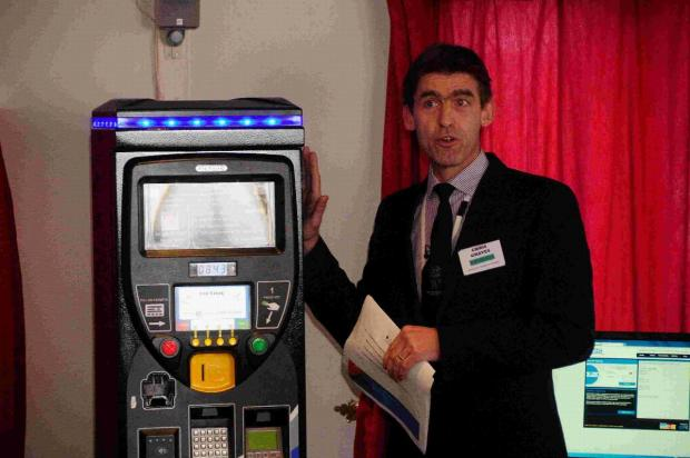 Dorset Echo: Chris Graves with one of the new state-of-the-art parking machines