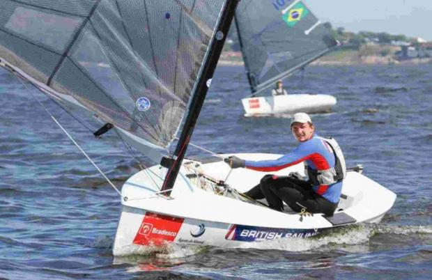 GOLDEN BOY: Giles Scott in his heavyweight Finn dinghy in Brazil