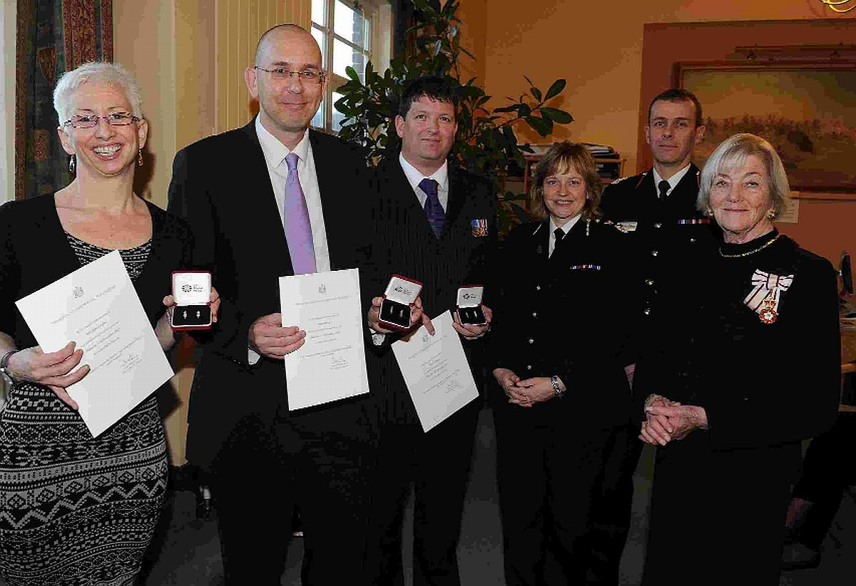 HEROES: From left, Joanne and Brian Keane and Andrew Bilton, receive the Queen's commendations for bravery. Presenting are Lord-Lieutenant Valerie Pitt-Rivers, right, chief constable Debbie Simpson and assistant chief fire officer Colin Chapman