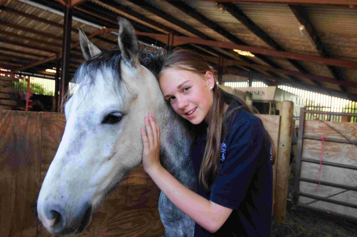 SAFE AND SOUND: Lexie Macduff, 11, with Boozie the horse following its rescue from a gate by a Bere Regis fire crew