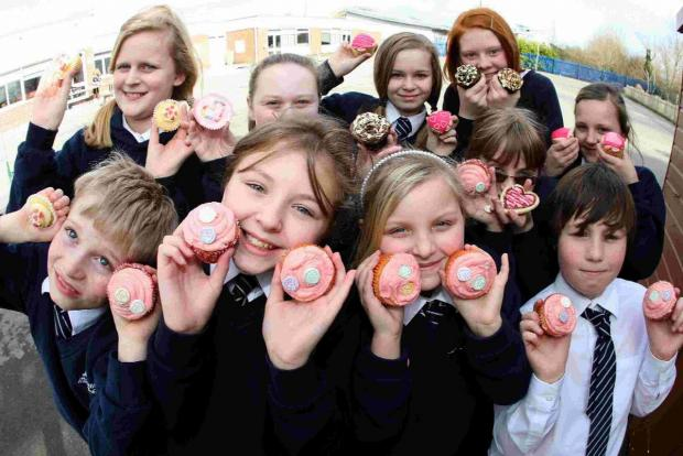 Pupils from Hamworthy Middle School hold a bake sale for Mosaic