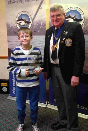TOP JUNIOR: Steven Patterson receives his European Federation of Sea Angling (UK) Junior Fish of the Year award