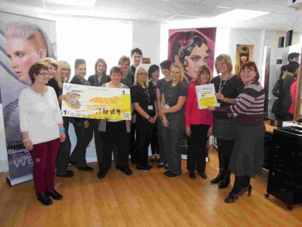 SCHEME: Students at Weymouth College Hair and Beauty with their tutor Gill Lenga, second from far right. Also present are volunteers from the Directions