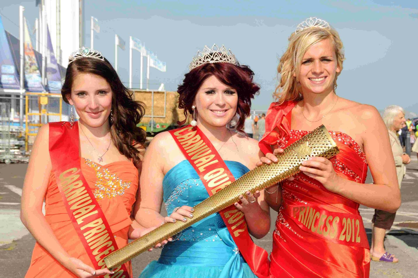 CARRYING THE TORCH: Miss Weymouth organiser Elysia Munday as the 2012 carnival queen with attendants Hannah Derrick and Gina Hartley