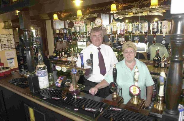 TIME AT THE BAR: Dan and Jackie Fox say goodbye to the Pulpit Inn