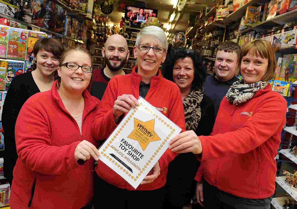 WELL DONE: Howley's Toymaster Weymouth manager Natasha Brittain, centre, and staff with the award