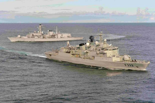 SISTER SHIPS: HMS Portland,  F79, with a Portuguese warship
