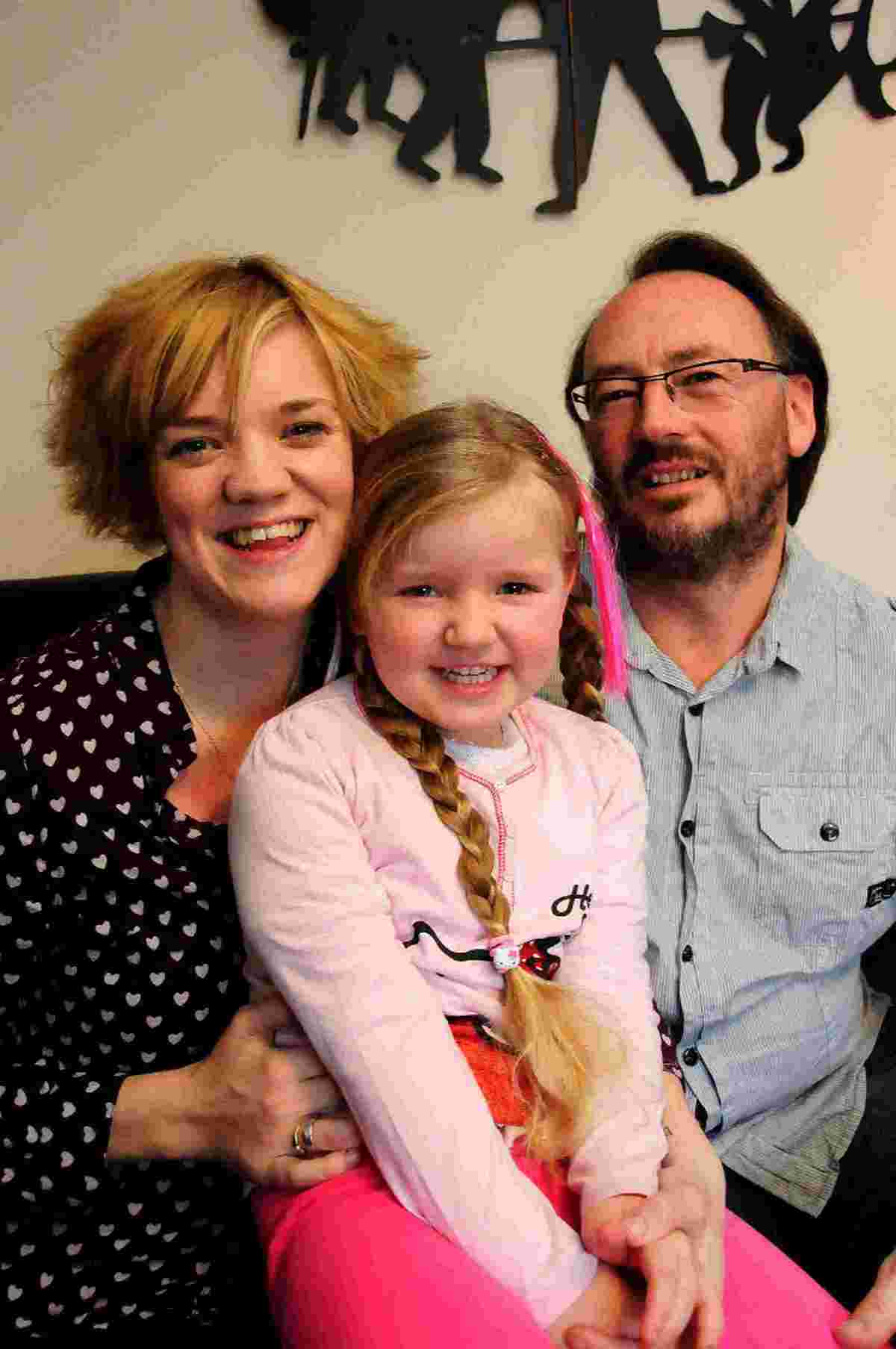 MUSICAL MUM: Chloe Evans-Lippett with her daughter Amelia-Rose and her husband Tony