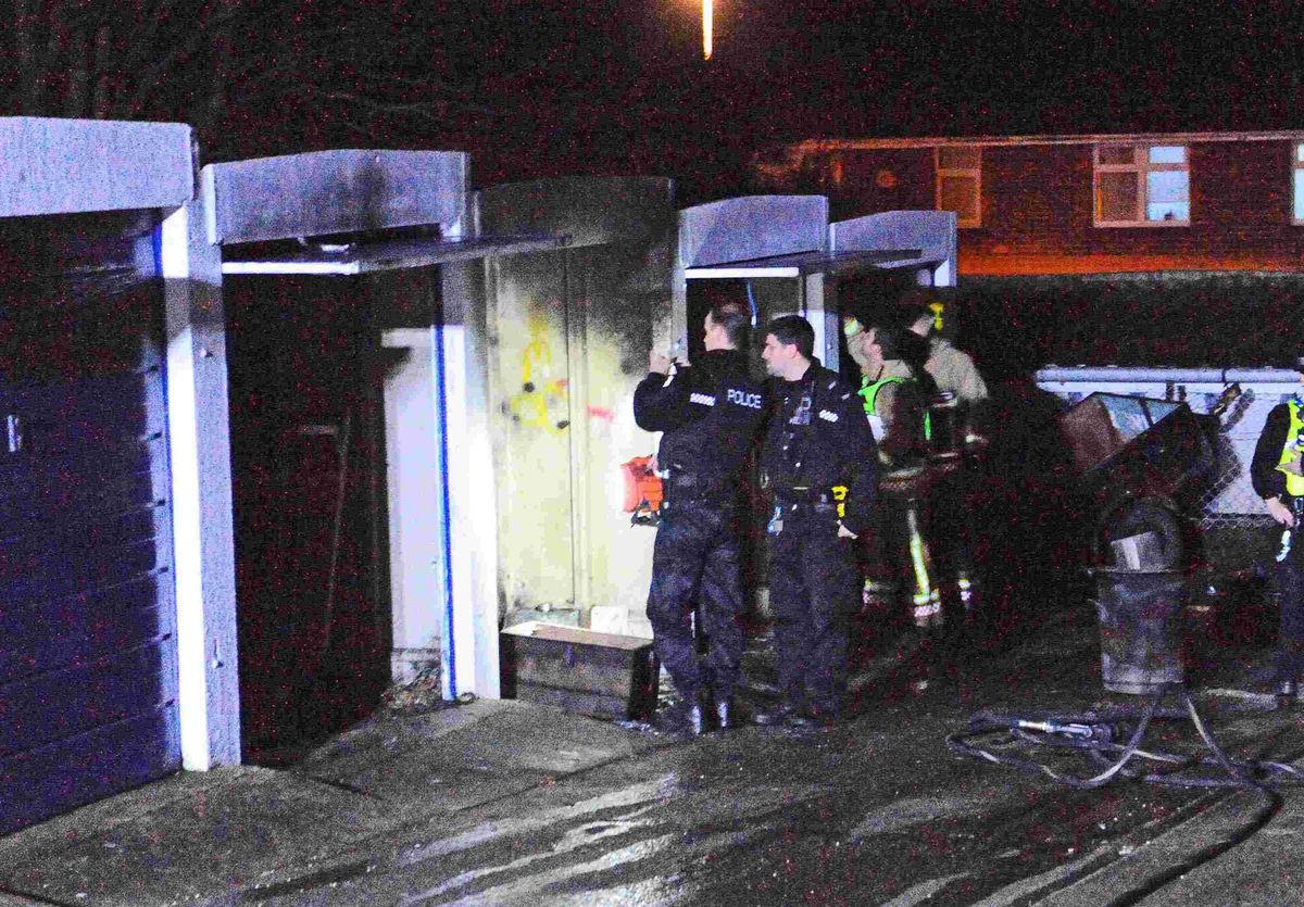 PROBE: Police and fire officers at the scene  Picture: GRAHAM HUNT