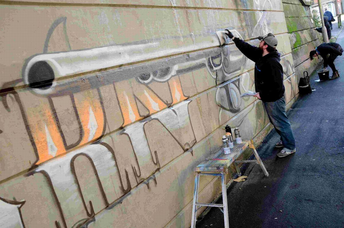 Dorchester graffiti wall depicting Western gun under fire from angry residents