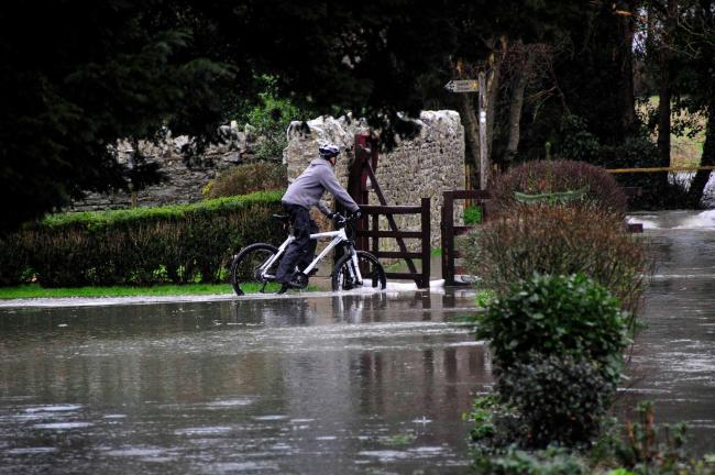 Floods alert as rainfall records smashed