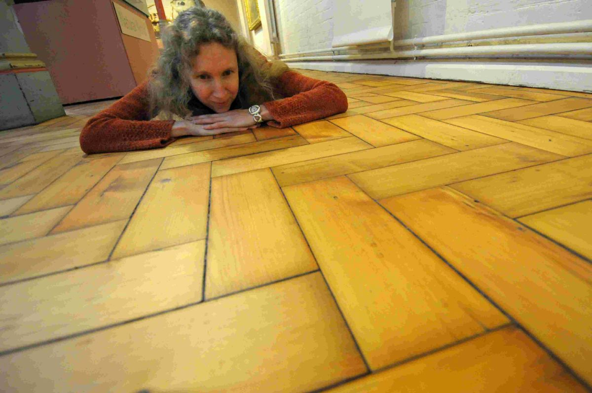 REOPENED: The completed floor in the Victorian Gallery at  Dorset County Museum is examined by Jenny Cripps