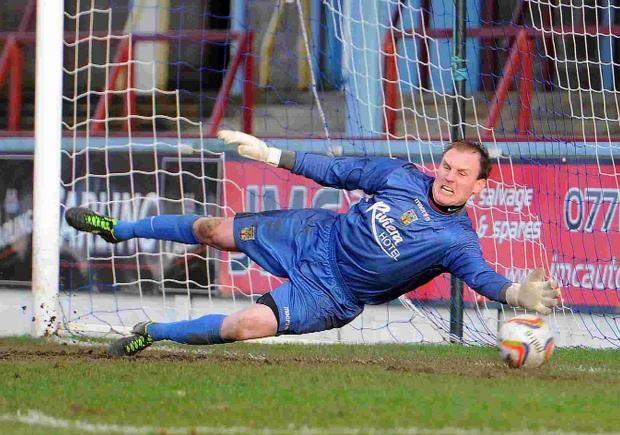 DESPAIRING DIVE: Weymouth keeper Jason Matthews watches another ball fly past him into the net