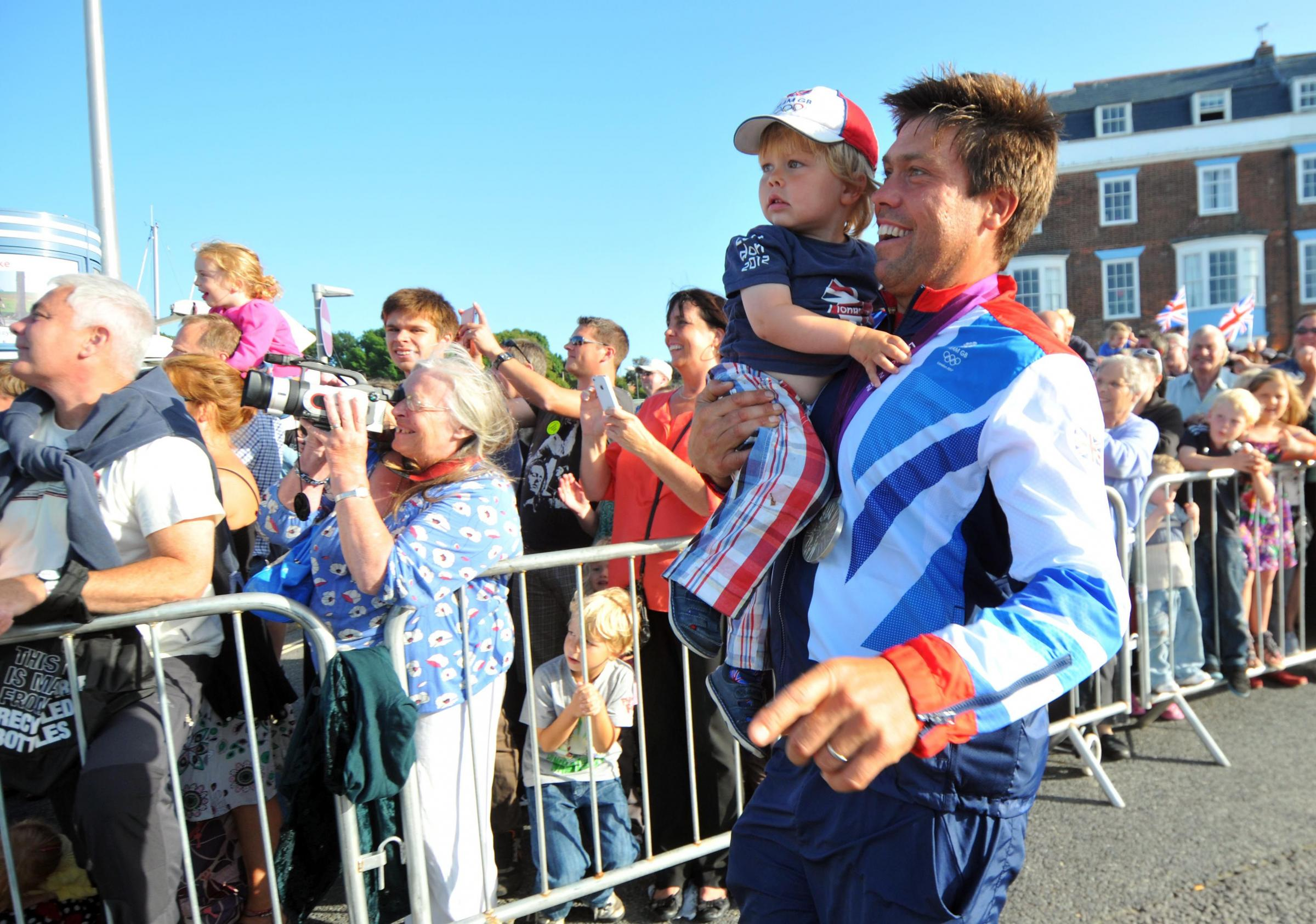 Andrew Simpson with son Freddie at Weymouth Carnival