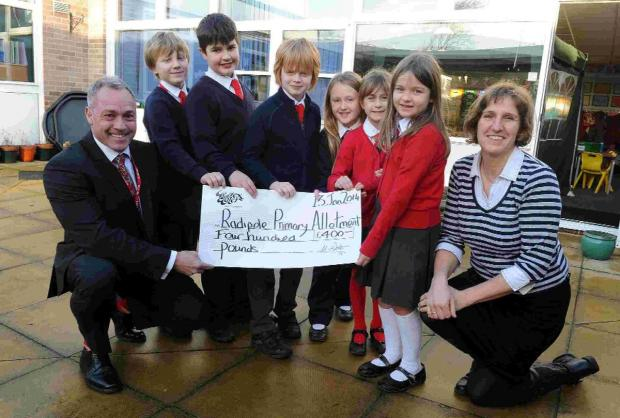 Simon Burdett of Wessex Water presents a cheque to students from Radipole School