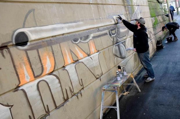 Peter Sheridan working on the 'good graffiti' project