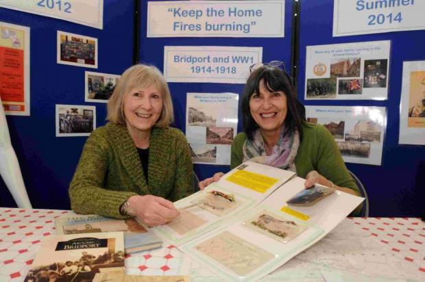 MEMORIES: Bridport Heritage forum members Muriel Finucane and Sheila Meaney, right, with memories from WW1 for a new exhibition