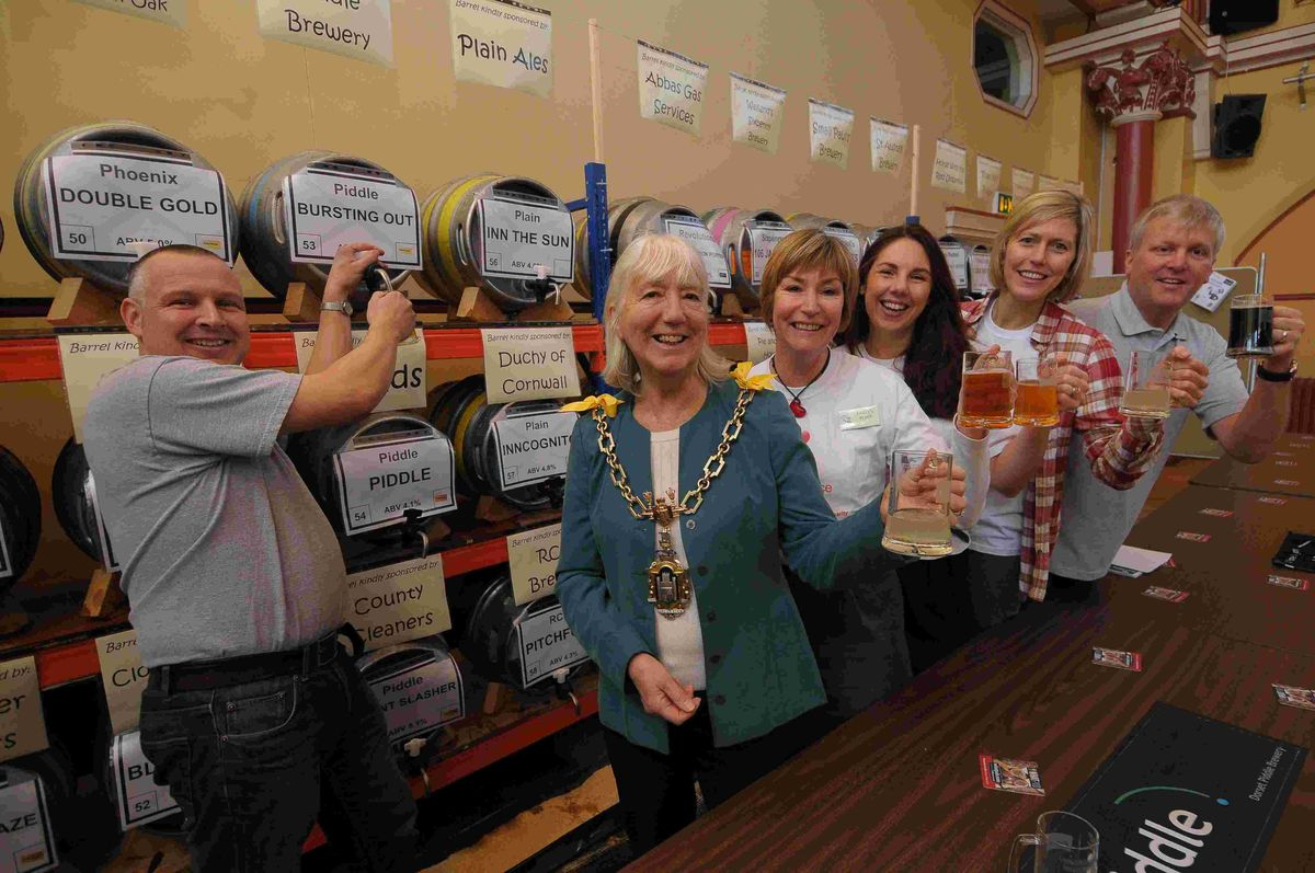 ALE AND HEARTY: Dorchester Mayor Stella Jones launches the town's annual beer festival with Richard Gabe (left) and members of Gully's Place, Pam Bell, Allison Ryder and Jayne Hugh with Ellis Ford.       Picture: JOHN GURD/JG9837