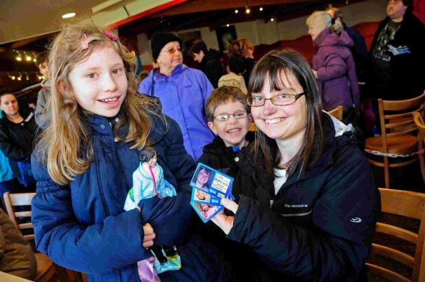 ALL SMILES: Dominique Ellis with her children Kate and Daniel with their passes