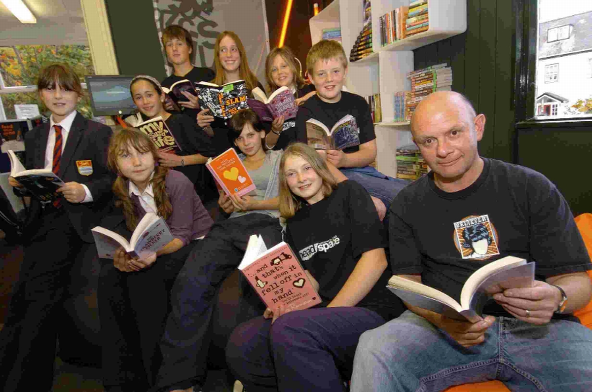 Author Nick Hornby at Lyme Regis library with youngsters