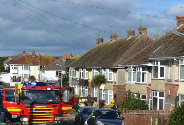 DRAMA: Firefighters at the scene in Dale Avenue. Picture by Linda Stevenson