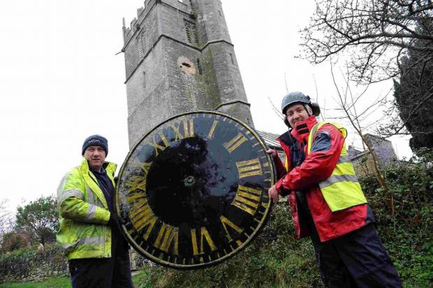 TIME GENTLEMEN: Tony Davies, left, and Chris Craven, from Smith's of Derby, with the clockface
