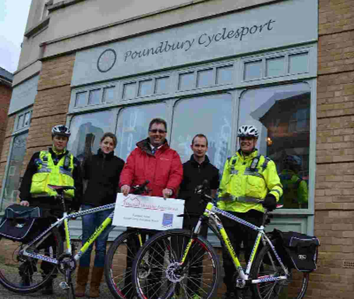 ON YOUR BIKES: From left, PCSO Sarah Hart, Heidi Gould, Ken Bodycombe, Darren Matthews, and PCSO Nick Maton