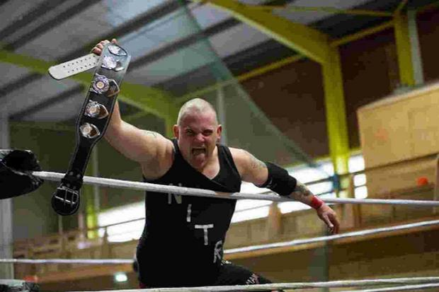 Dorset Echo: COUNTY CROWN: Robbie Nitro celebrates after winning the Dorset Middleweight Championship