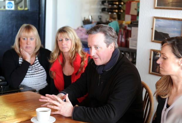 Dorset Echo: PRAISE: David Cameron with Jackie Breakspear and Amanda Broughton-South plus Storm Wallace, right, at the Cove House Inn.  Picture: FINNBARR WEBSTER