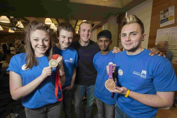 GOOD HEALTH: Lucy and other members of the National Deaf Children's Society Young People's Advisory Board with Paralympian Ben Rushgrove