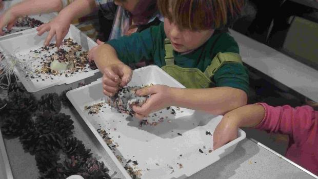 FEATHERED FRIENDS: Children making fat balls for birds at Lorton Meadows