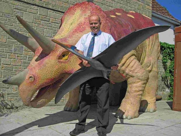 HANDFUL:  Museum curator Tim Batty gets to grips with his dinosaurs